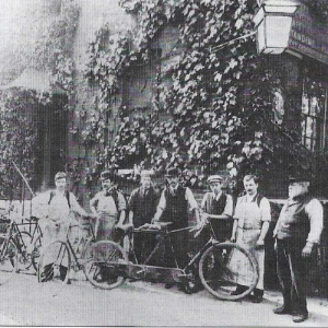 staff outside historic shop of wilsons cycles
